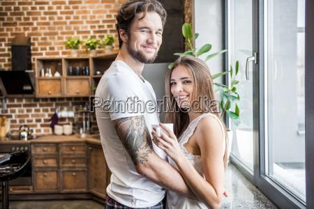 smiling, man, hugging, woman - 20559071