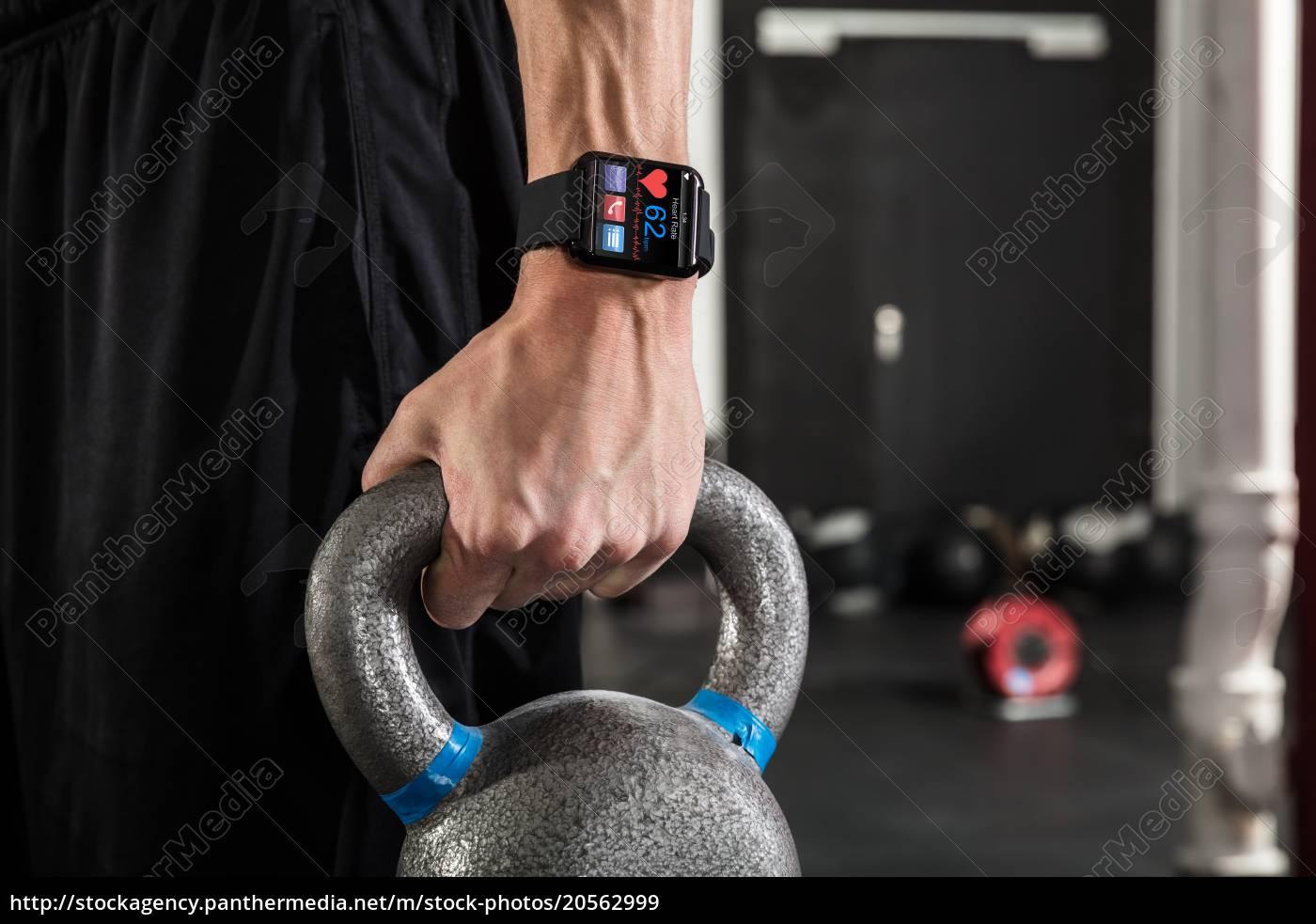 an, athlete, man, holding, kettle, bell - 20562999