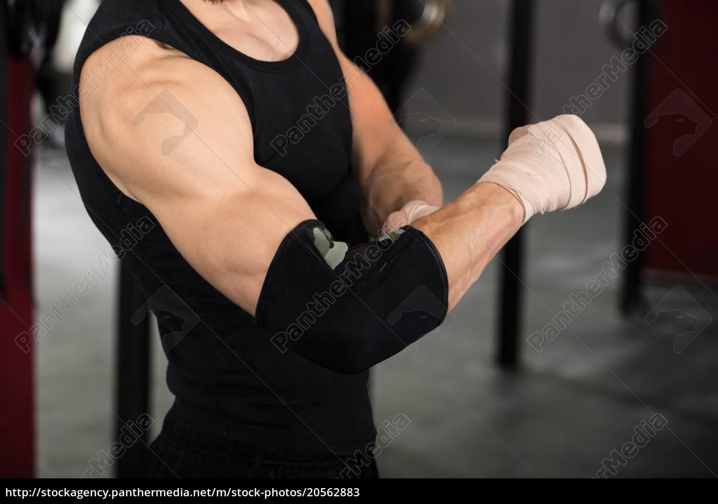 athlete, person, wearing, bandage, on, elbow - 20562883