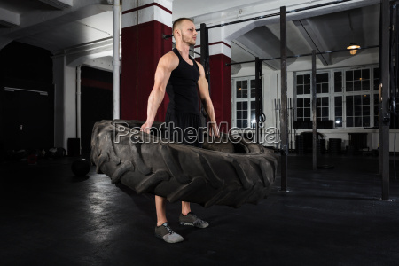 man, doing, exercise, with, tire - 20562899