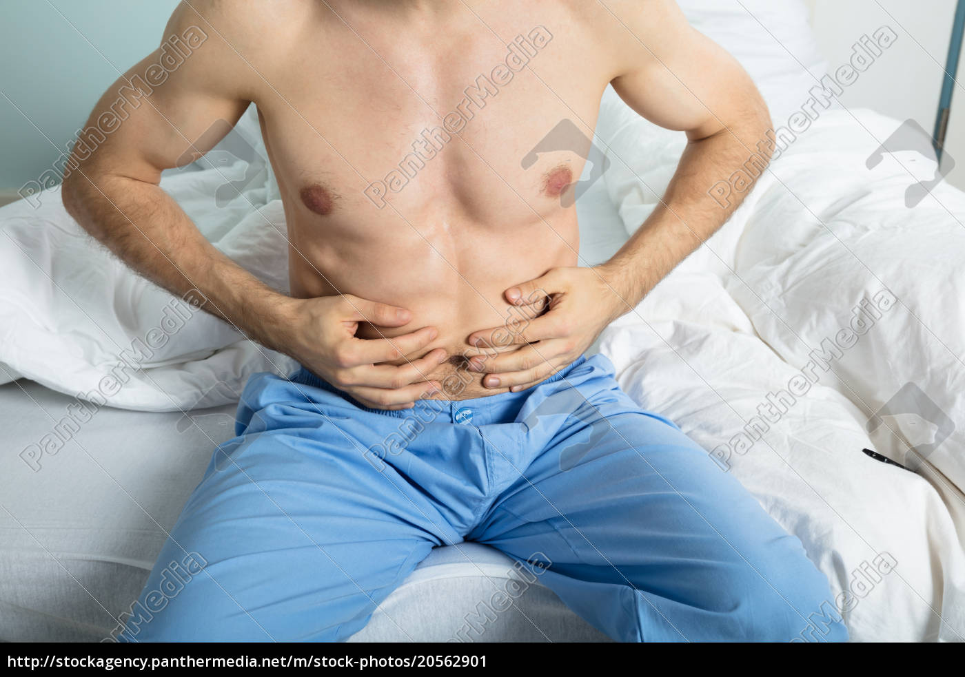 man, suffering, from, stomach, ache - 20562901