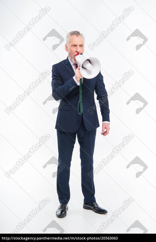 businessman, shouting, in, loudspeaker - 20563063