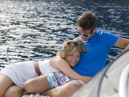 teenagers cuddle together on mediterranean sea