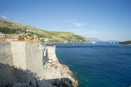 tourists at city wall of dubrovnik
