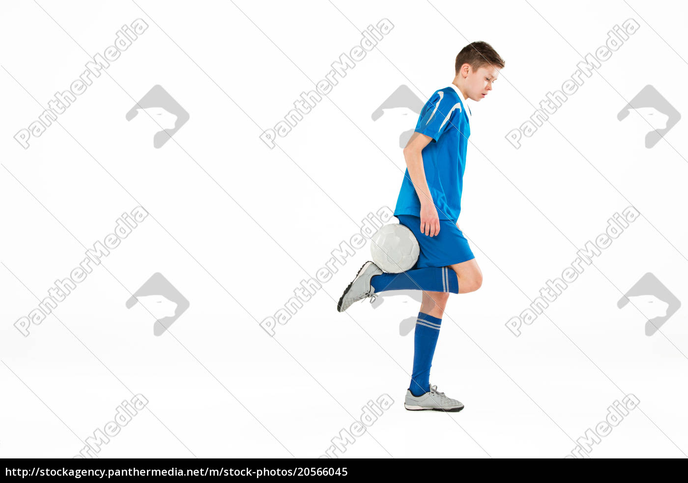 young, boy, with, soccer, ball, doing - 20566045
