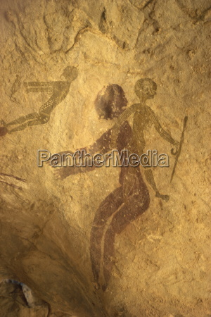 rock paintings of decorated woman and
