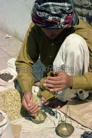 man using scales karachi pakistan asia