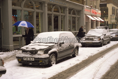 cars covered in snow in winter