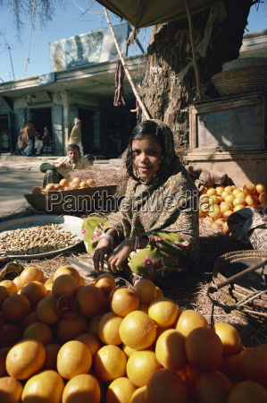 girl selling fruit near peshawar pakistan