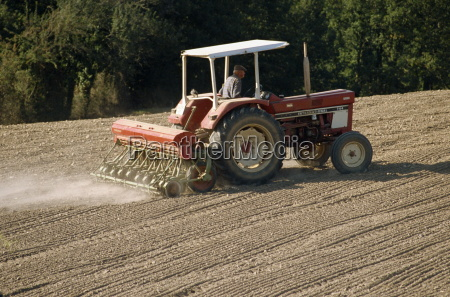 a tractor with a seed drill