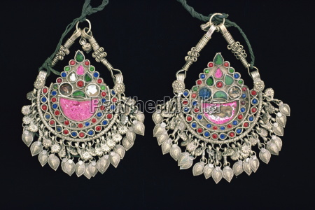 ornate silver pendants from tribal area