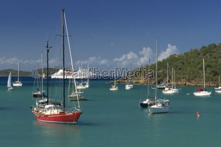 sailing boats and cruise ship moored
