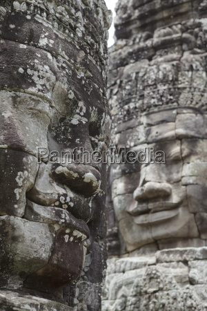 smiling faces carved in stone bayon