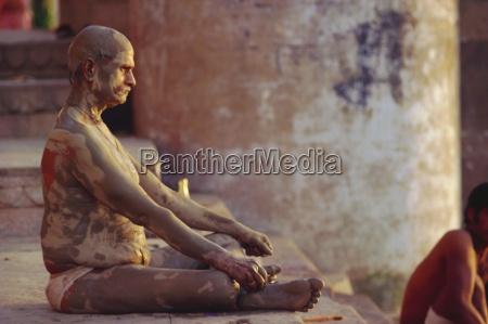 hindu pilgrim meditating sitting cross legged