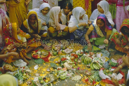 women at the lakshmi puja festival