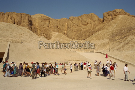 tourists visiting tombs in the valley