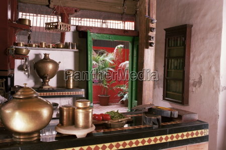 kitchen area with traditional brass cooking
