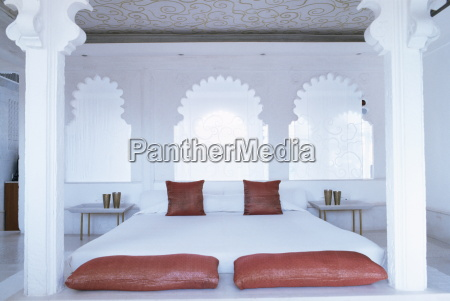 bedroom suite with traditional cusped arches