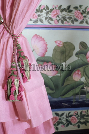 tassels pink curtains and painted walls