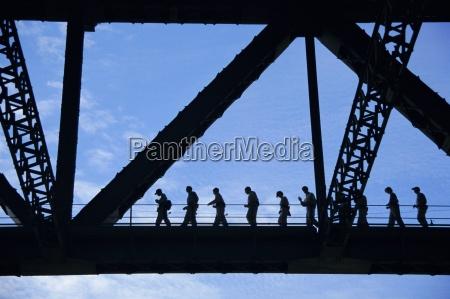 bridge climb participants in silhouette sydney