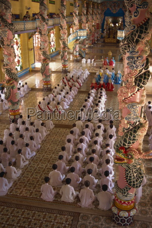 rows of monks at prayer inside