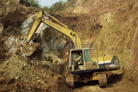 machine digging gem bearing clay in