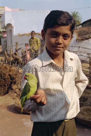 boy with pet parrot dhariyawad rajasthan