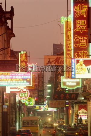 traffic and neon signs in the