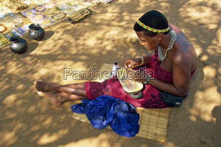 zulu girl making necklaces south africa