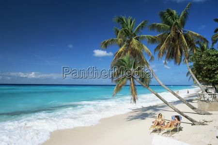 sunbathers on worthing beach on the