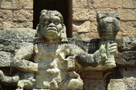 the mayan rain god chac holding
