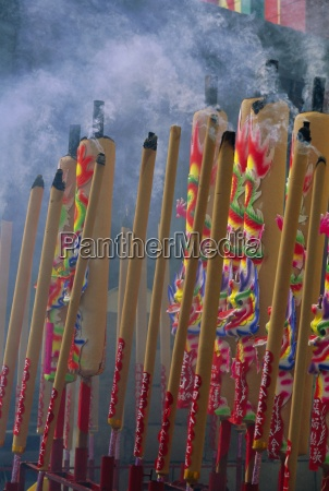 burning incense on religious holiday chinatown