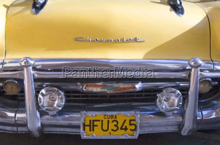 a bright yellow vintage 1950s chevrolet