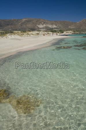 white sand and emerald sea at