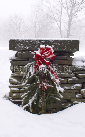 a snow covered christmas wreath of