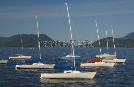 sailboats moored in lake george with