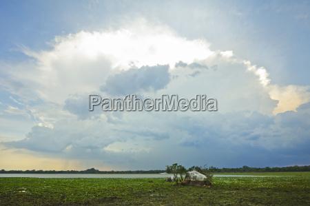 backlit storm cloud over a lagoon