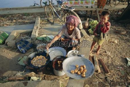 woman selling bananas and rice balls
