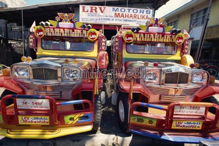 pair of customised jeepney trucks the