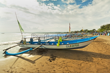 outrigger fishing boats on west beach