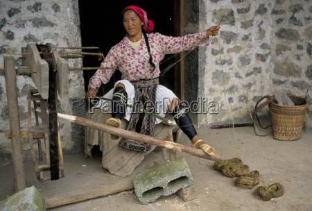 woman twisting hemp north guangxi china