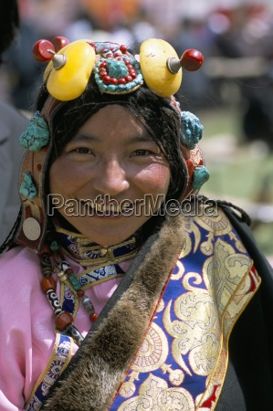 young woman wearing typical amber jewellery