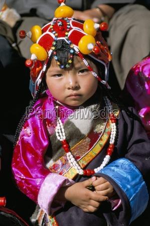 little girl wearing traditional amber jewellery