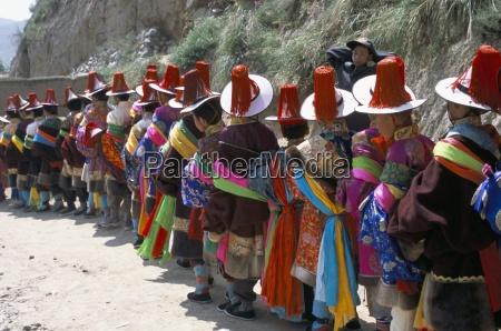 line of people wearing tibetan traditional