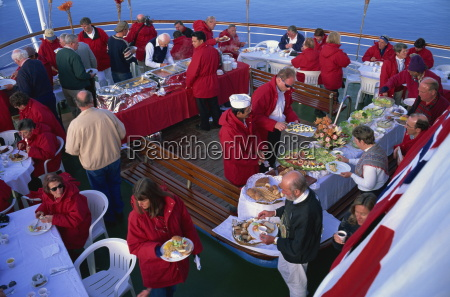 passengers at a bbq on cruise