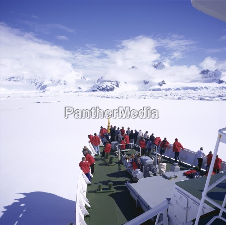 tourists on deck of a cruise