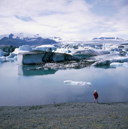 a glacial lagoon with icebergs carved