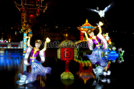 chinese lanterns reflected on a lake
