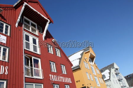converted warehouses along harbour front tromso
