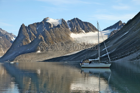 yacht anchored under a glacier magdalenefjord